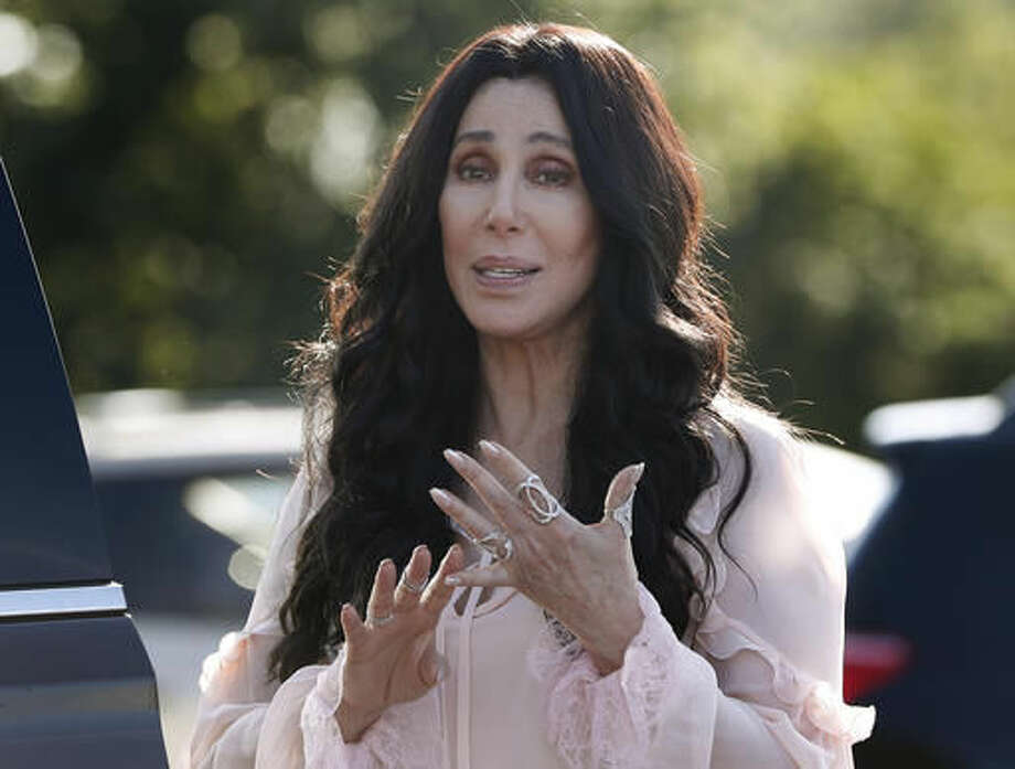 FILE - In a Sunday, Aug. 21, 2016 file photo, singer and actress Cher stops to talk to media as she leaves a fundraiser for Democratic presidential candidate Hillary Clinton at the Pilgrim Monument and Provincetown Museum in Provincetown, Mass. Cher is returning to the stage in 2017 for a series of performances on both sides of the country. The pop legend's residency, launches Feb. 8 in Las Vegas. (AP Photo/Carolyn Kaster, File)