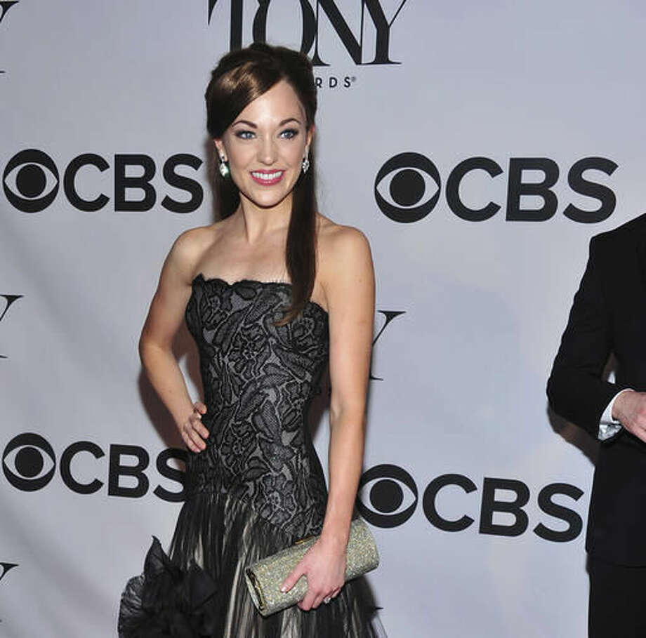 "FILE - In this June 9, 2013 file photo, Laura Osnes arrives on the red carpet at the 67th Annual Tony Awards, in New York. ""The Bandstand,"" the story of six WWII veterans who join together in Cleveland to compete in a radio contest with dreams of stardom, has secured a Shubert theater and has an opening night of April 26, 2017. It will co-star Osnes, who has been attached to the show since a reading 2½ years ago. (Photo by Charles Sykes/Invision/AP, File)"