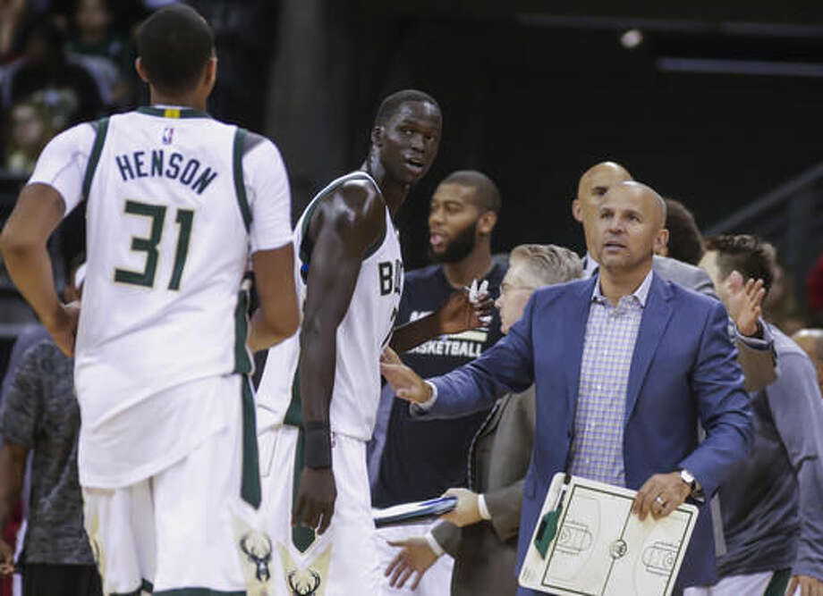 FILE - In this Oct. 8, 2016, file photo, Milwaukee Bucks coach Jason Kidd, right, talks with team members John Henson (31) and Thon Maker during the second half of the team's NBA preseason basketball game against the Dallas Mavericks in Madison, Wis. Kidd wants to revert the defense back to its 2014-15, when the Bucks allowed just 97.4 points per game and allowed opponents to shoot 43.7 percent. Milwaukee allowed 103.2 points on 45.4 percent shooting last year. The Bucks hope to rely on their length and athleticism on both ends of the floor. (AP Photo/Andy Manis, File)