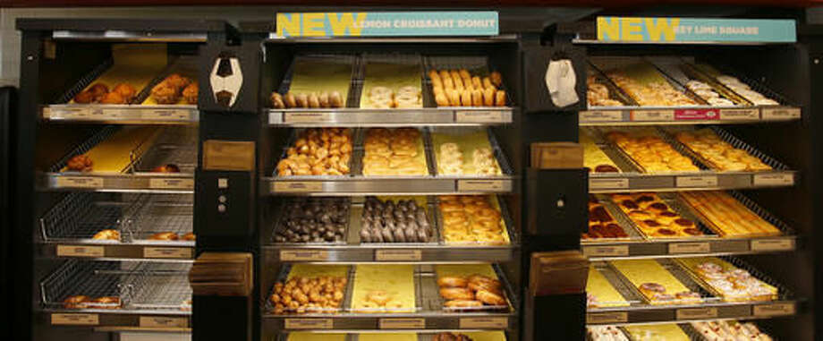 This Thursday, July 28, 2016, photo shows donuts for sale at a Dunkin' Donuts in Edmond, Okla. Dunkin' Brands Group, Inc. is expected to report financial earnings Thursday, Oct. 20, 2016. (AP Photo/Sue Ogrocki)