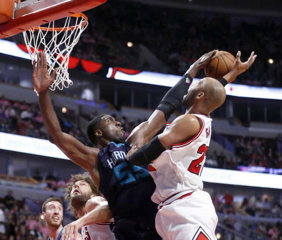 Charlotte Hornets' Roy Hibbert, left, blocks the shot of Chicago Bulls' Taj Gibson during the second half of an NBA preseason basketball game, Monday, Oct. 17, 2016, in Chicago. The Hornets won in overtime 108-104. (AP Photo/Charles Rex Arbogast)