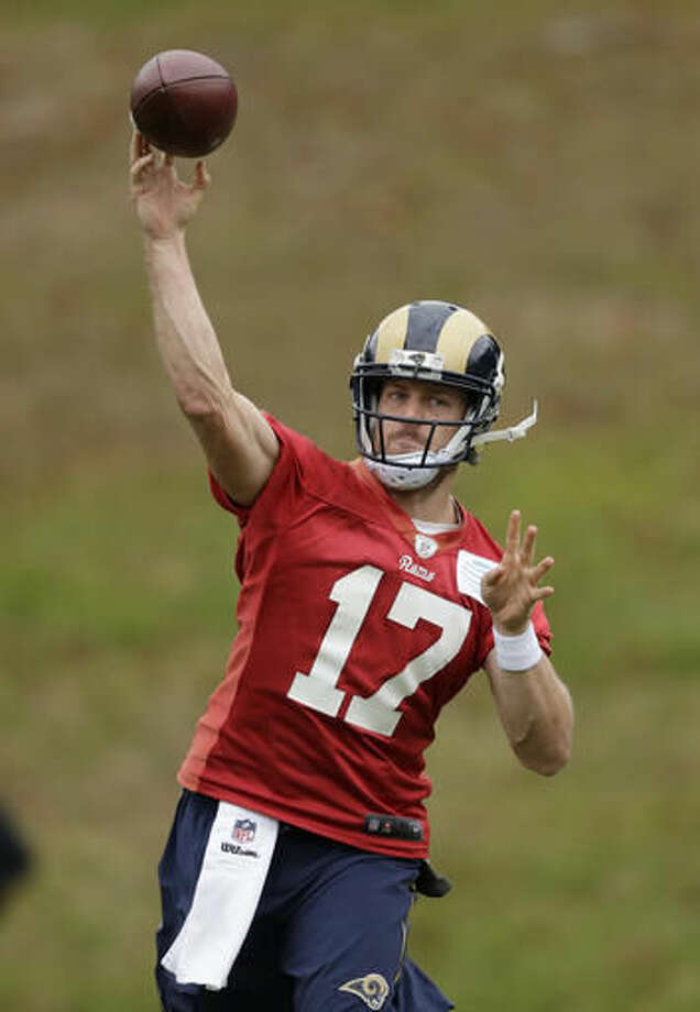Los Angeles Rams quarterback Case Keenum takes part in a practice session at Pennyhill Park Hotel in Bagshot, England, Thursday, Oct. 20, 2016. The Los Angeles Rams are due to play the New York Jets at Twickenham stadium in London on Sunday in a regular season NFL game. (AP Photo/Matt Dunham)