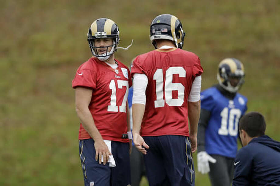 Los Angeles Rams quarterbacks Case Keenum, left, and Jared Goff, 16, take part in a practice session at Pennyhill Park Hotel in Bagshot, England, Thursday, Oct. 20, 2016. The Los Angeles Rams are due to play the New York Giants at Twickenham stadium in London on Sunday in a regular season NFL game. (AP Photo/Matt Dunham)
