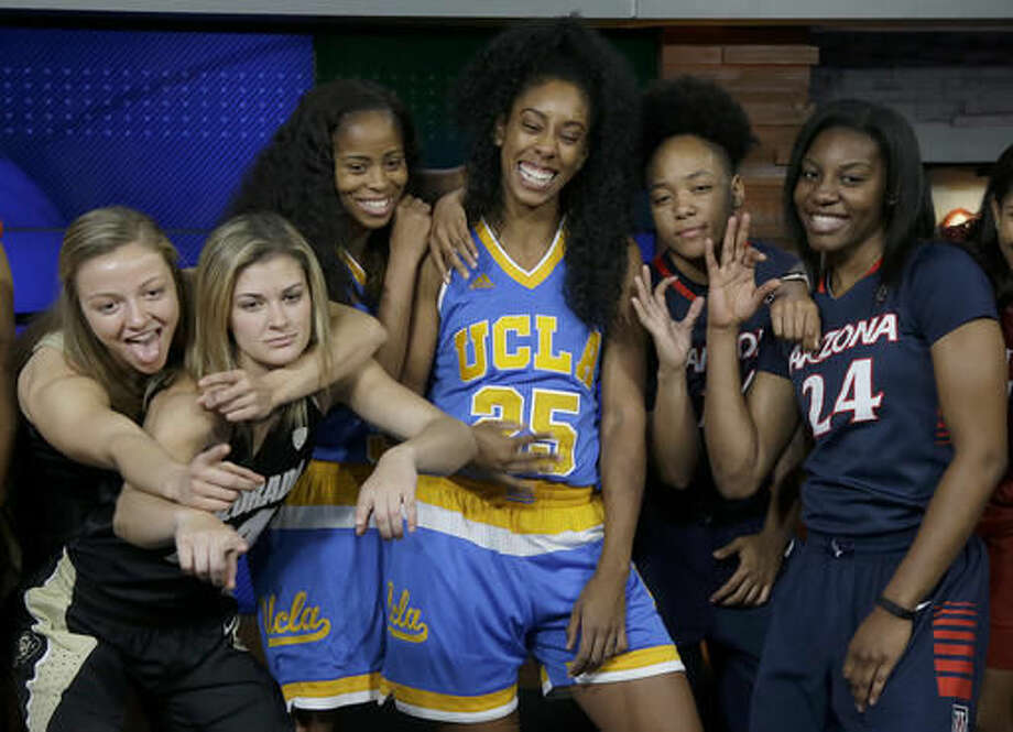Colorado's Kennedy Leonard, from left, poses for photos with teammate Lauren Huggins, UCLA's Jordin Canada and Monique Billings, and Arizona's Malena Washington and LaBrittney Jones during NCAA college basketball Pac-12 media day in San Francisco, Thursday, Oct. 20, 2016. (AP Photo/Jeff Chiu)
