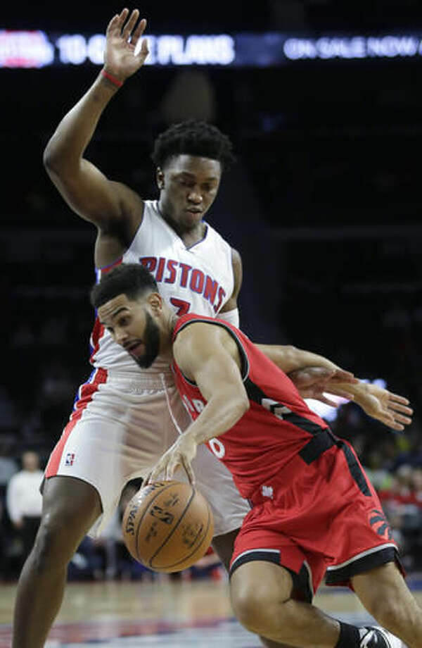 Toronto Raptors' Cory Joseph drives to the basket against Detroit Pistons' Stanley Johnson during the second half of an NBA preseason basketball game Wednesday, Oct. 19, 2016, in Auburn Hills, Mich. (AP Photo/Duane Burleson)