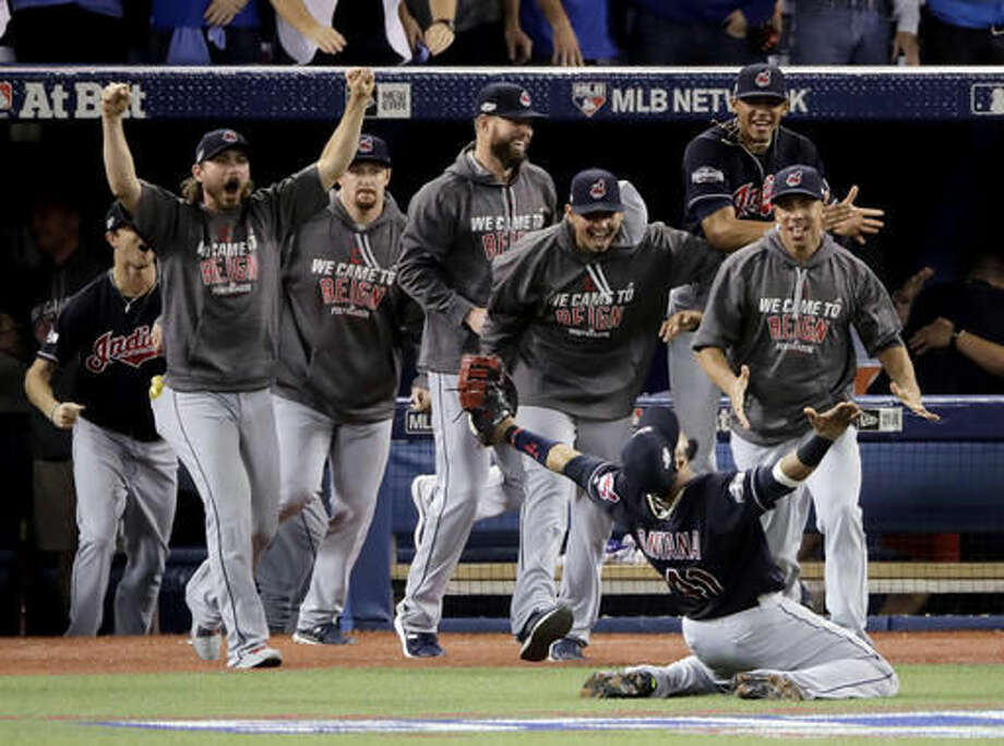 FILE - In this Wednesday, Oct. 19, 2016, file photo, Cleveland Indians first baseman Carlos Santana celebrates after making the final out in their 3-0 win over the Toronto Blue Jays in Game 5 of baseball's American League Championship Series in Toronto. Four months after LeBron James and the Cavaliers ended the city's championship drought at 52 years by winning the NBA title, the Indians are back in the World Series for the first time since 1997. (AP Photo/Charlie Riedel, File)