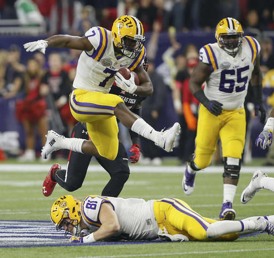 FILE - In this Dec. 29, 2015, file photo, LSU running back Leonard Fournette (7) hurdles tight end Colin Jeter (81) as he rushes against Texas Tech during the first half of the Texas Bowl NCAA college football game in Houston. Lately, the 25th-ranked Tigers have spread out formations and scored on a variety of big plays, and now it appears running back Leonard Fournette could return to the mix for this weekend's clash with No. 23 Mississippi. (AP Photo/Bob Levey, File)