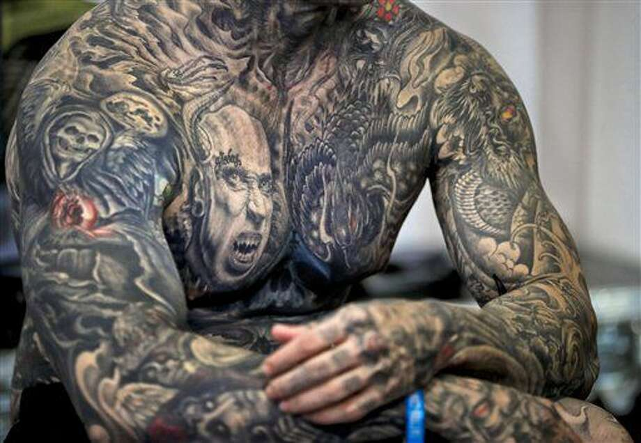 b05991f6b AP PHOTOS: Tattoo artists gather for convention in Romania - The ...