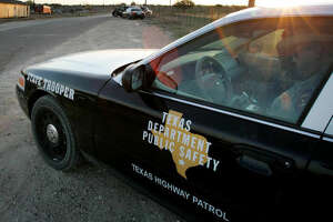 """FILE - In this April 6, 2008, file photo, a Texas State Trooper is shown sitting in his vehicle in Eldorado, Texas. Drivers in Texas busted for drunken driving, not paying child support or low-level drug offenses are among thousands of """"high-threat"""" criminal arrests that officials have touted in defense of a nearly $1 billion mission to secure the border with Mexico, an Associated Press analysis has found. (AP Photo/Tony Gutierrez, File)"""