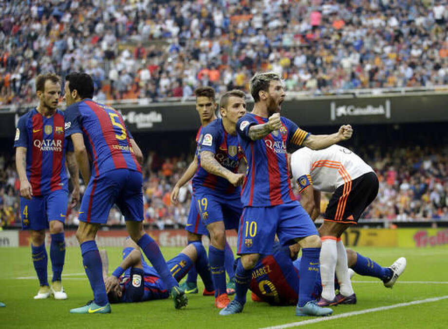 FC Barcelona's Lionel Messi celebrates after scoring a penalty during the Spanish La Liga soccer match between Valencia and FC Barcelona at the Mestalla stadium in Valencia, Spain, Saturday, Oct. 22, 2016. (AP Photo/Manu Fernandez)