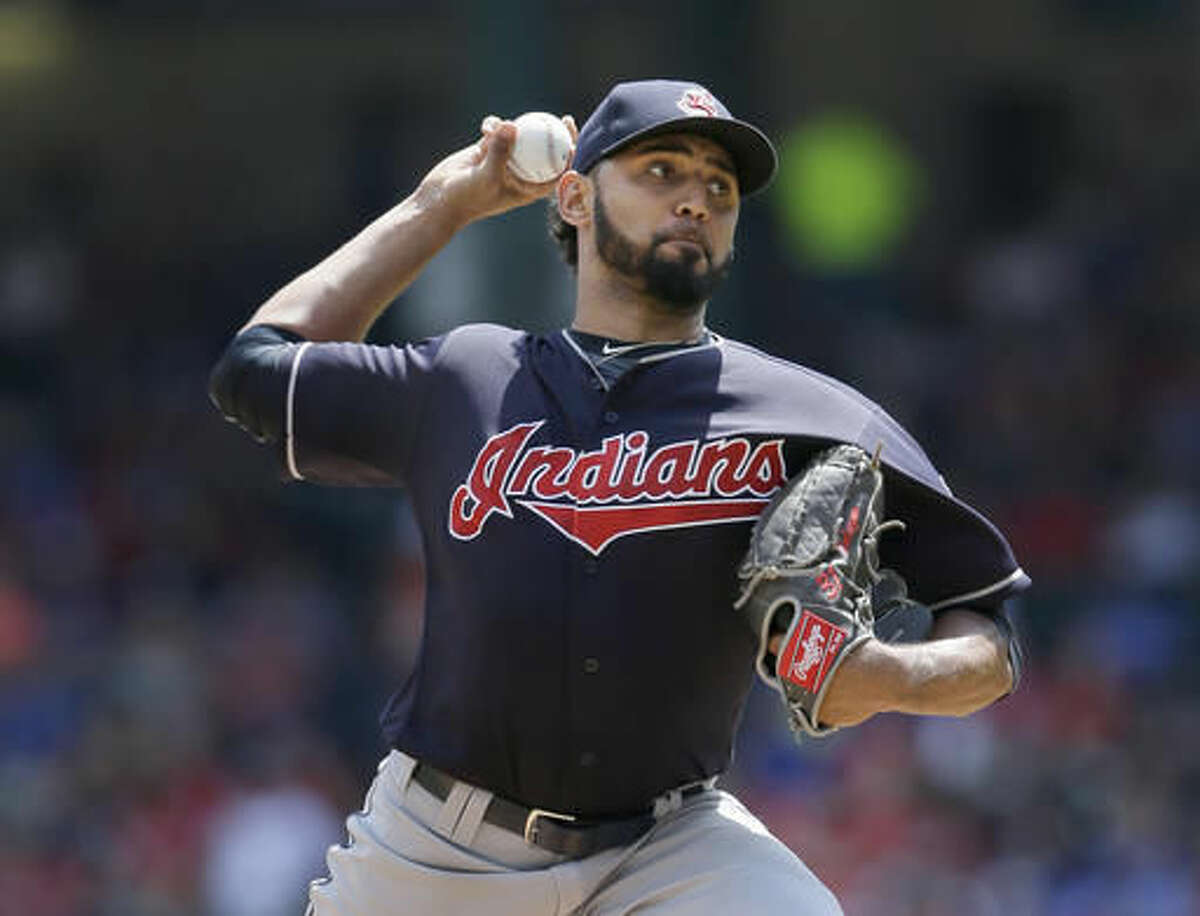 """FILE - In this Aug. 28, 2016, file photo, Cleveland Indians starting pitcher Danny Salazar throws during the team's baseball game against the Texas Rangers in Arlington, Texas. Salazar, who hasn't pitched since Sept. 9 because of tightness in his right forearm, has thrown well in recent bullpen sessions and might be able to pitch for the first time in this postseason. Manager Terry Francona said Friday, Oct. 21, that Salazar has """"let it go"""" during some recent workout and has not been restricted to throwing only fastballs and change-ups. (AP Photo/LM Otero, File)"""