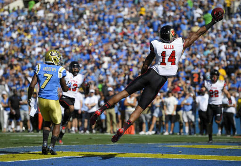 Utah defensive back Brian Allen, right, almost intercepts a pass in the end zone that was intended for UCLA wide receiver Darren Andrews during the first half of an NCAA college football game, Saturday, Oct. 22, 2016, in Pasadena, Calif. (AP Photo/Mark J. Terrill)