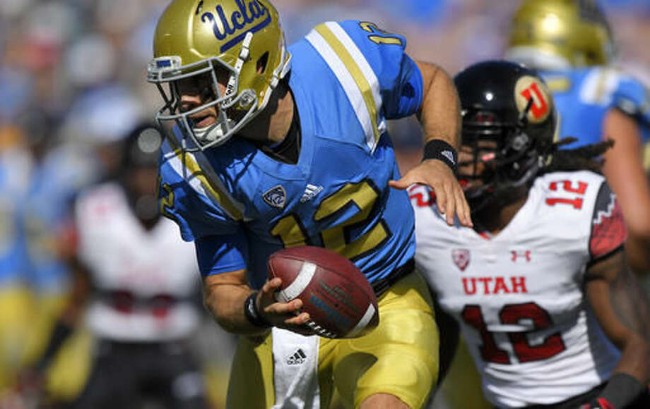 UCLA quarterback Mike Fafaul, left, tries to get away from Utah defensive back Justin Thomas during the first half of an NCAA college football game, Saturday, Oct. 22, 2016, in Pasadena, Calif. (AP Photo/Mark J. Terrill)