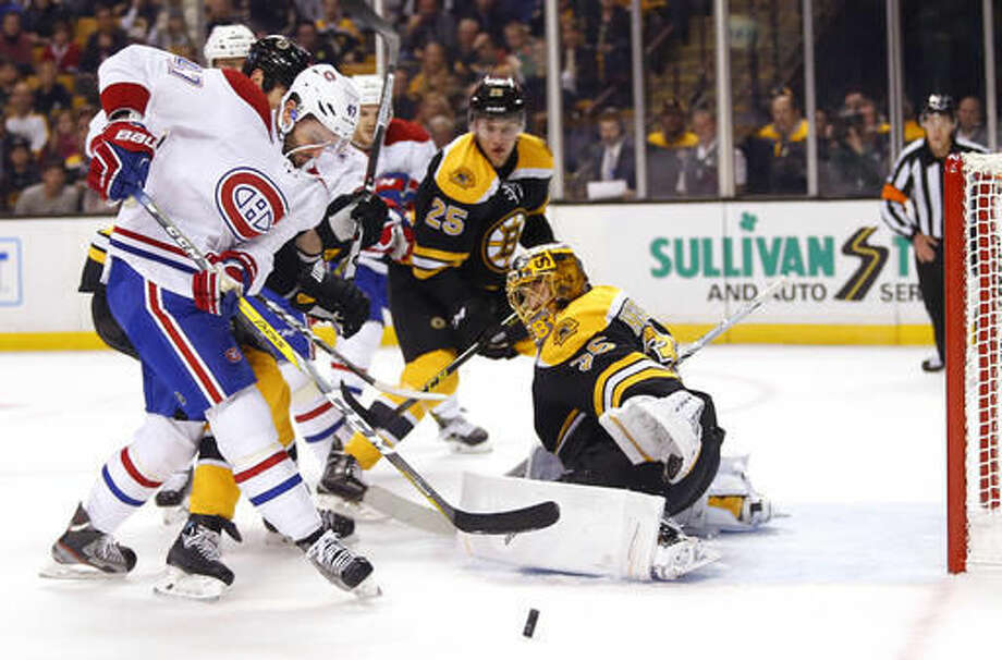 Montreal Canadiens' Alexander Radulov looks for a rebound along side of Boston Bruins goalie Anton Khudobin during the first period of an NHL hockey game in Boston on Saturday, Oct. 22, 2016. (AP Photo/Winslow Townson)