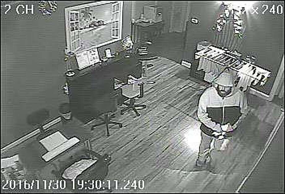 Shelton police are looking for this heavy-set man with a beard who is wanted for burglaries at the Hair Do Salon and Linda's liquors, both on Bridgeport Avenue. The burglaries happened on Nov. 27 and Nov. 30, 2016. If anyone recognizes the man in the attached photograph, they are encouraged contact the Shelton Police Department at (203) 924-1544. All call will be kept confidential. Photo: Shelton Police Department