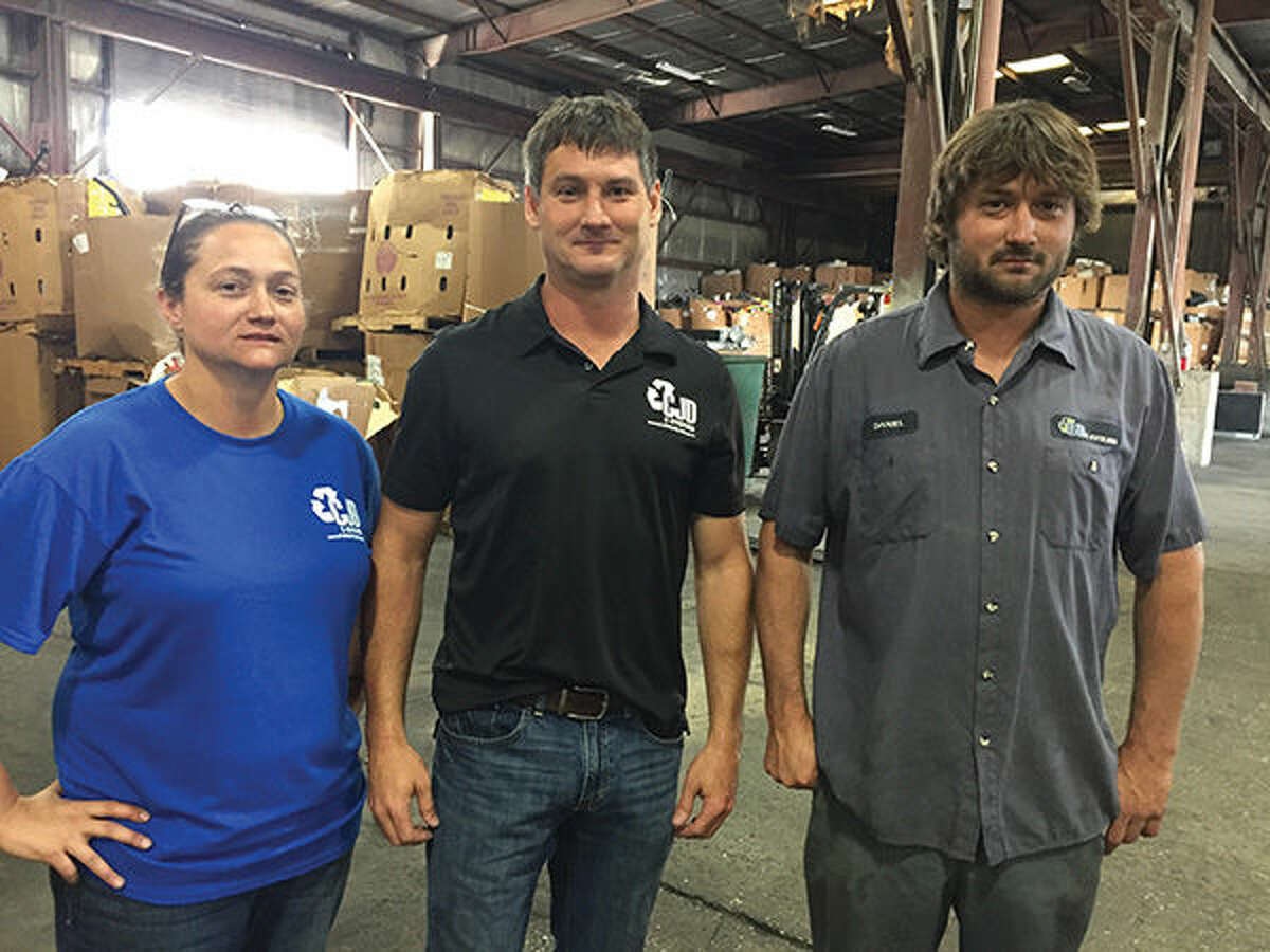 Pictured are Catherine, Jonathan and Daniel Wolff of CJD E-Cycling.