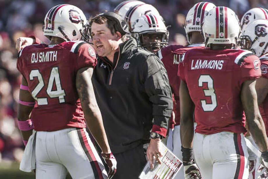 South Carolina head coach Will Muschamp talks with defensive back D.J. Smith (24) during the second half of an NCAA college football game against Massachusetts Saturday, Oct. 22, 2016, in Columbia, S.C. South Carolina defeated Massachusetts 34-28. (AP Photo/Sean Rayford)