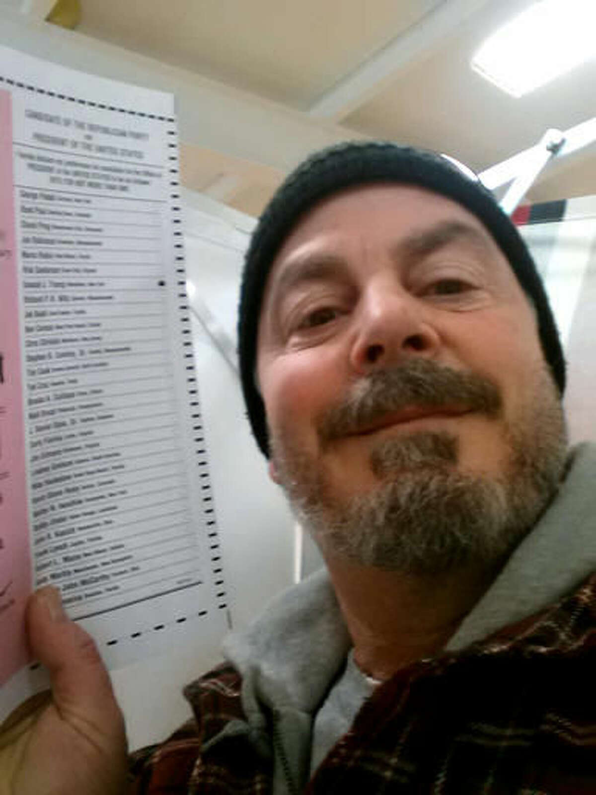 In this Feb. 9, 2016, photo, provided by Bill Phillips, of Nashua, N.H., Phillips takes a selfie with his marked election ballot. The secrecy of the voting booth may soon be a thing of the past. Ballot selfies, where people use smartphones to photograph and share their marked ballots online, are becoming more common, as voters young and old look to share their views with family, friends and the world. But what they don't realize is they may be breaking the law, depending on where they live. (Bill Phillips via AP)
