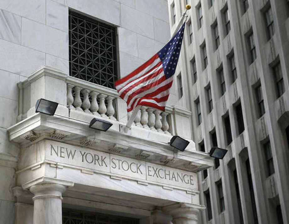 FILE - This Monday, Aug. 24, 2015, file photo shows the New York Stock Exchange. U.S. stocks continue to slide early Wednesday, Oct. 26, 2016. Technology companies are taking some of the biggest losses as investors weren't impressed with Apple's latest results. Energy companies are falling with the price of oil. (AP Photo/Seth Wenig, File)