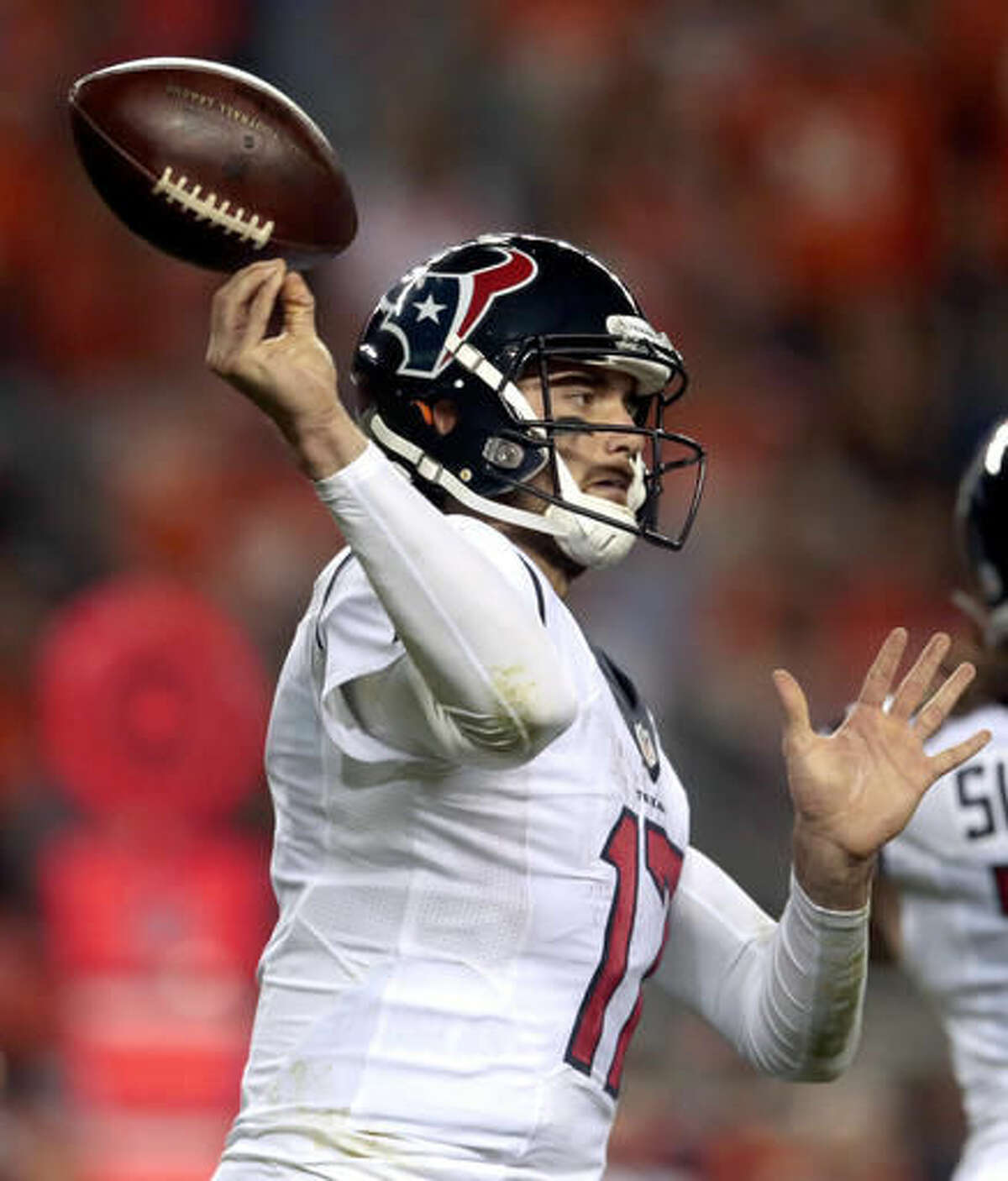 Houston Texans quarterback Brock Osweiler (17) bobbles the throw during the second half of an NFL football game against the Denver Broncos, Monday, Oct. 24, 2016, in Denver. (AP Photo/Joe Mahoney)