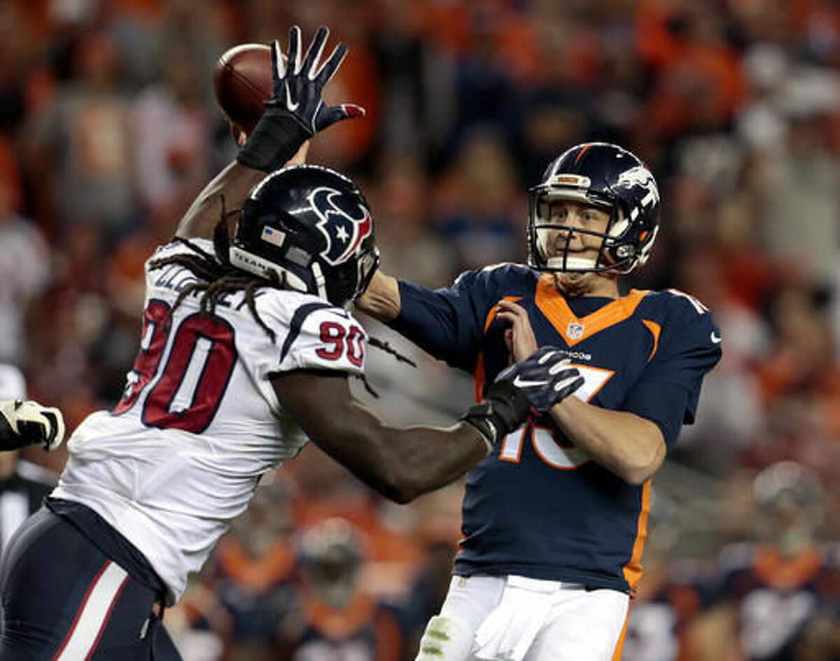 Denver Broncos quarterback Trevor Siemian (13) throws under pressure from Houston Texans defensive end Jadeveon Clowney (90) during the second half of an NFL football game, Monday, Oct. 24, 2016, in Denver. (AP Photo/Joe Mahoney)