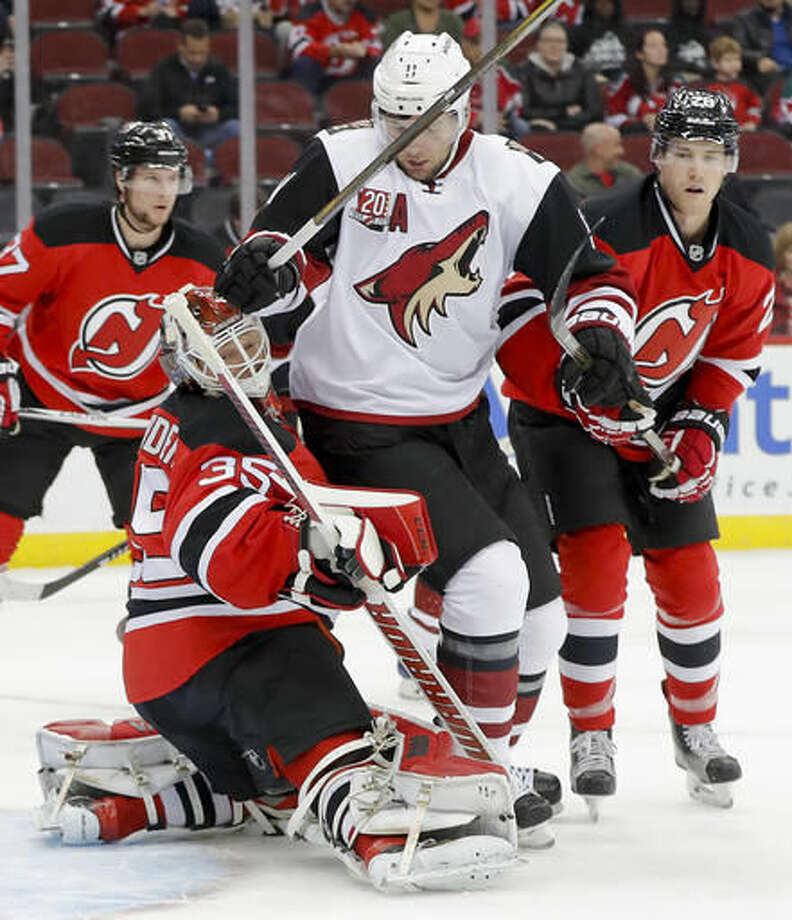 a0c19d865d0 sale arizona coyotes center martin hanzal 11 collides with new jersey  devils goalie cory schneider 5b636