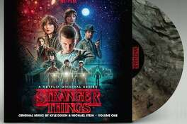 """""""Stranger Things"""" Soundtrack Volume One and Volume Two ($24.98 suggested retail list price for """"VHS"""" black, $29.98 suggested retail list price for colored variant, see filmmusicdaily.com/vinyl-store for buying info): The hit Netflix series """"Stranger Things"""" gave us more than just a riveting dose of '80s genre-flick nostalgia and the murky mirror dimension known as the Upside Down. It also gave us the equally haunting synthesizer music of Kyle Dixon and Michael Stein from the Austin synth band S U R V I V E. Lakeshore Records has several vinyl spins of that """"Stranger Things"""" music, with a double-LP release for each of the soundtrack's two volumes. Choose from basic """"VHS"""" black vinyl or special copies on colored vinyl."""