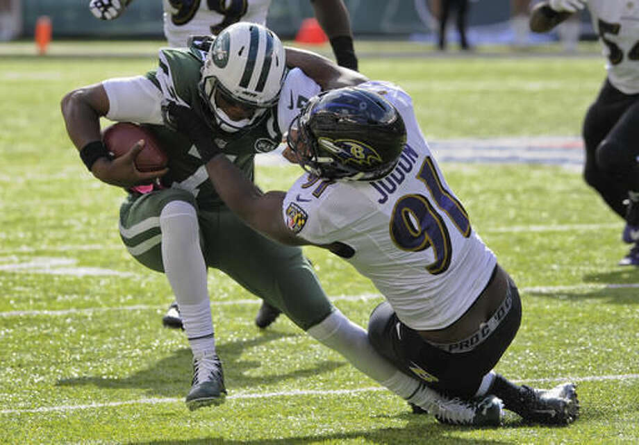 New York Jets quarterback Geno Smith (7) is sacked by Baltimore Ravens linebacker Matt Judon (91) during the second quarter of an NFL football game, Sunday, Oct. 23, 2016, in East Rutherford, N.J. (AP Photo/Bill Kostroun)