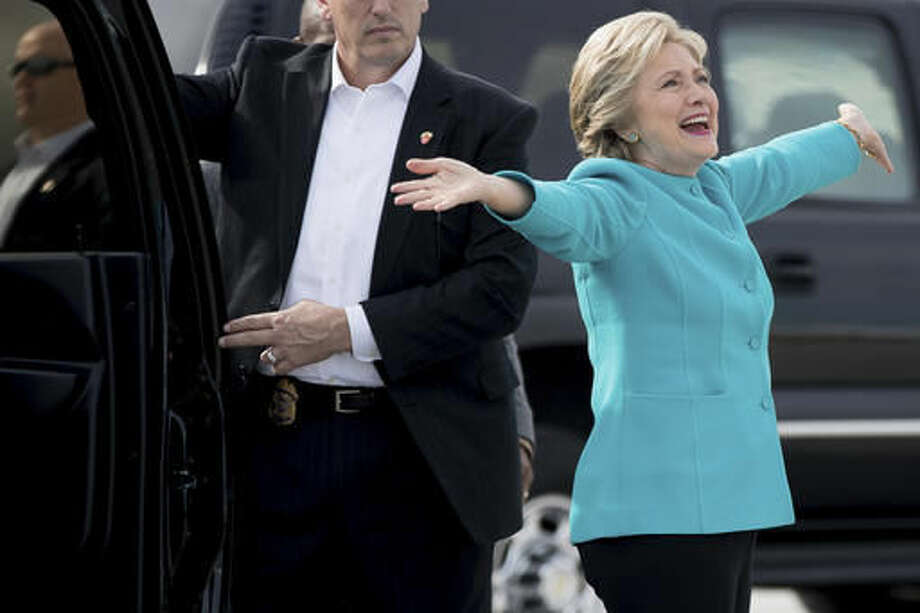 Democratic presidential candidate Hillary Clinton reacts to a reporters questions about her birthday before boarding her campaign plane at Miami International Airport in Miami, Wednesday, Oct. 26, 2016, to travel to Lake Worth, Fla. for a rally. Clinton turns 69 today. (AP Photo/Andrew Harnik)