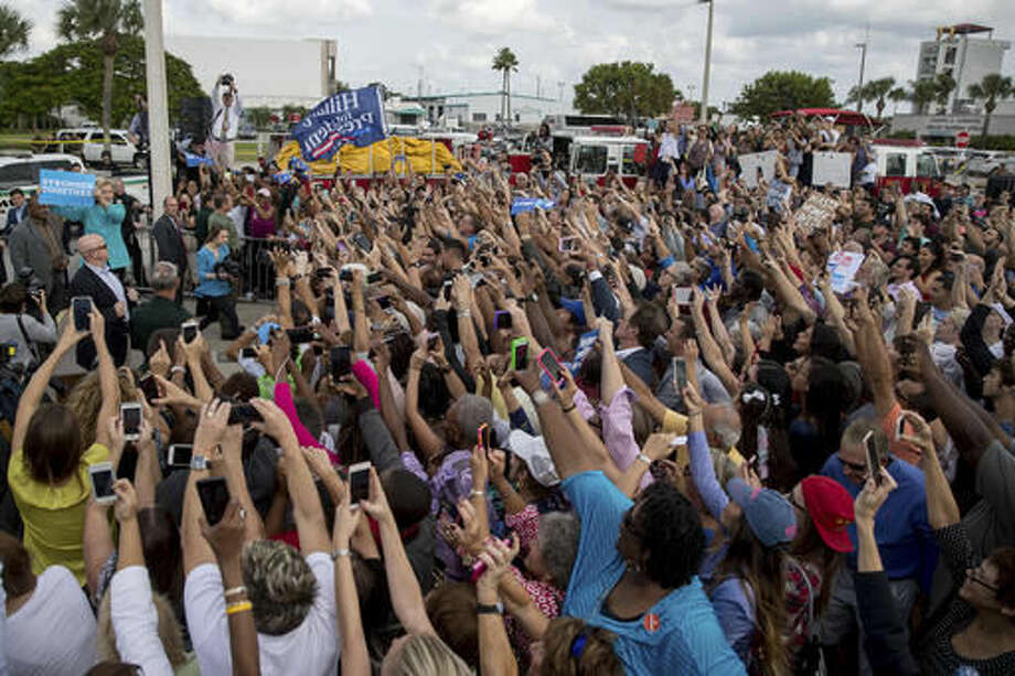 Democratic presidential candidate Hillary Clinton greets an overflow area outside a rally at Palm Beach State College in Lake Worth, Fla., Wednesday, Oct. 26, 2016. (AP Photo/Andrew Harnik)