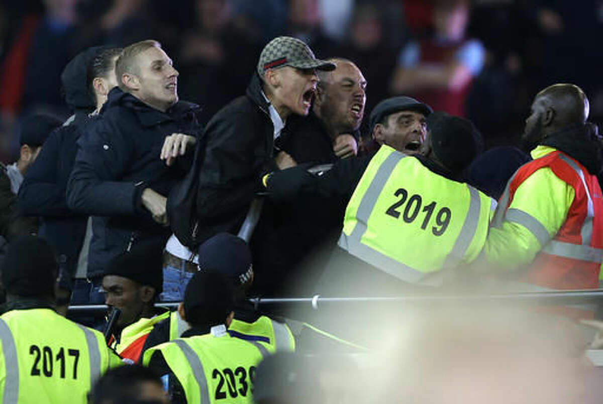 Supporters and stewards clash during the English League Cup soccer match between West Ham United and Chelsea at the London stadium in London in London, Wednesday, Oct. 26, 2016. West Ham defeated Chelsea by 2-1. (AP Photo/Alastair Grant)