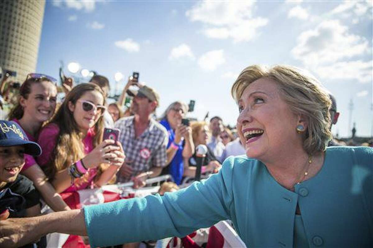 Democratic presidential nominee Hillary Clinton greets supporters following a