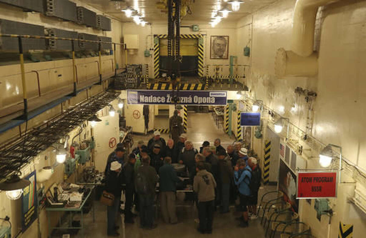 In this picture taken on Wednesday, Sept. 21, 2016, a group of tourists visits a museum of the Cold War nuclear arms race located at the Brdy reserve in Brdy, Czech Republic. In the deep forests of Brdy, there's a unique concrete installation known under the code name Javor (Maple) 51 which is believed to be used by the Soviet Army as a top secret depot to store nuclear war heads during the Cold War. A former military zone near Prague has been turning into a protected nature reserve and opening to the public after almost a century. (AP Photo/Petr David Josek)