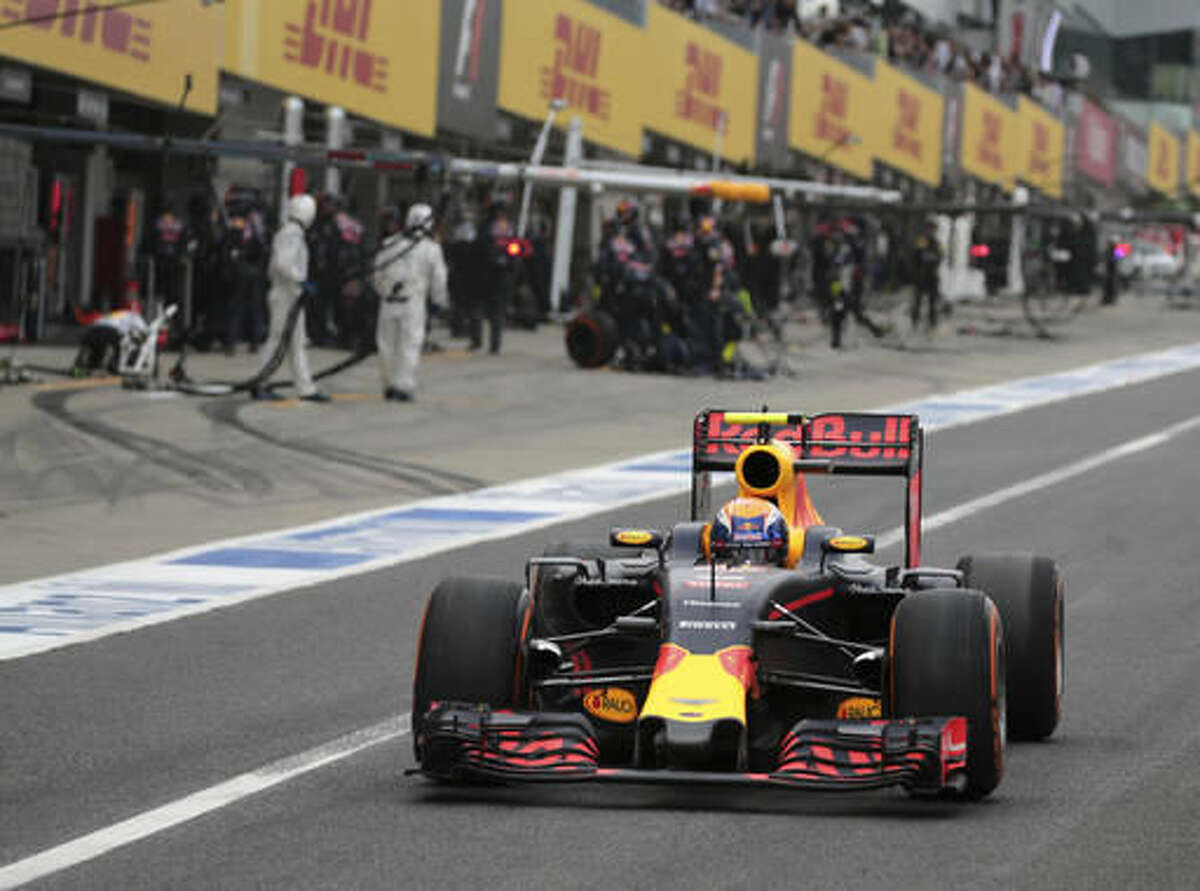FILE - In this Oct. 9, 2016, file photo, Red Bull driver Max Verstappen, of the Netherlands, steers his car out of the garage on the way to finishing second in the Japanese Formula One Grand Prix at the Suzuka International Circuit in Suzuka, central Japan. Verstappen is the son of race driver Jos Verstappen, who made 106 career Formula One starts, and his talent caught a lot of attention from teams growing up. Mercedes team principal Toto Wolff tried to sign Verstappen when he was 14 before Red Bull snagged him. (Yuya Shino/Pool Photo via AP, File)