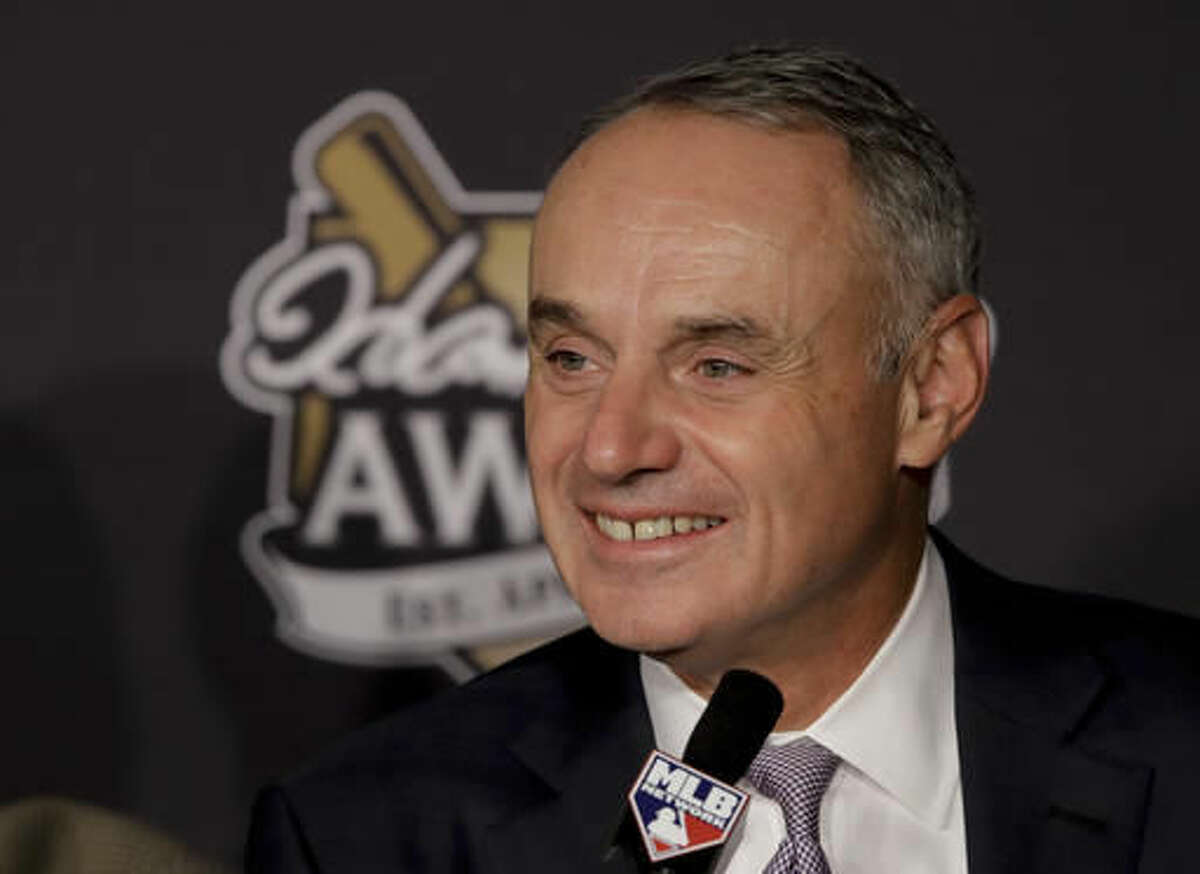 Commissioner, Robert D. Manfred, Jr. smiles during the Hank Aaron Awards before Game 2 of the Major League Baseball World Series between the Cleveland Indians and the Chicago Cubs Wednesday, Oct. 26, 2016, in Cleveland. (AP Photo/Gene J. Puskar)