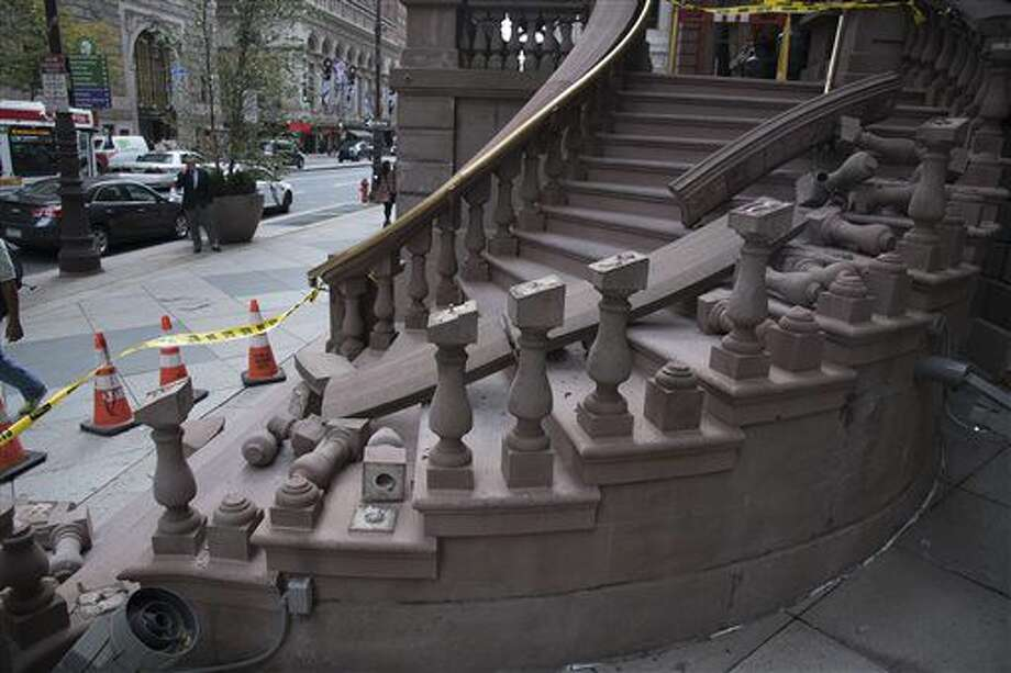 The north side of the grand staircase entrance to The Union League was damaged in the early morning hours of Monday, Oct. 24, 2016 as someone apparently tried to rip the brass railing off its supports to resell for money. (Clem Murray/The Philadelphia Inquirer via AP)