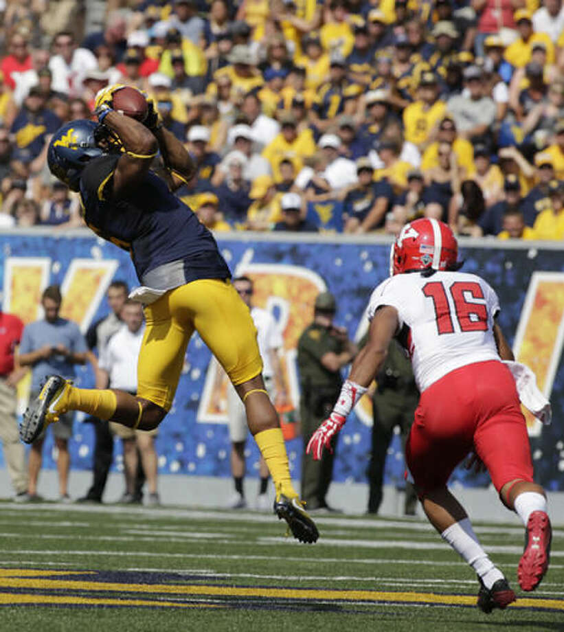 FILE - In this Sept. 10, 2016, file photo, West Virginia wide receiver Daikiel Shorts (6) makes a catch as Youngstown State wide receiver Jermiah Braswell (16) closes in for a tackle during the first half of an NCAA college football game, in Morgantown, W.Va. Shorts was among a group of receivers that made diving catches last week against TCU and will be looking for more on Saturday when No. 10 West Virginia travels to play Oklahoma State. (AP Photo/Raymond Thompson, File)