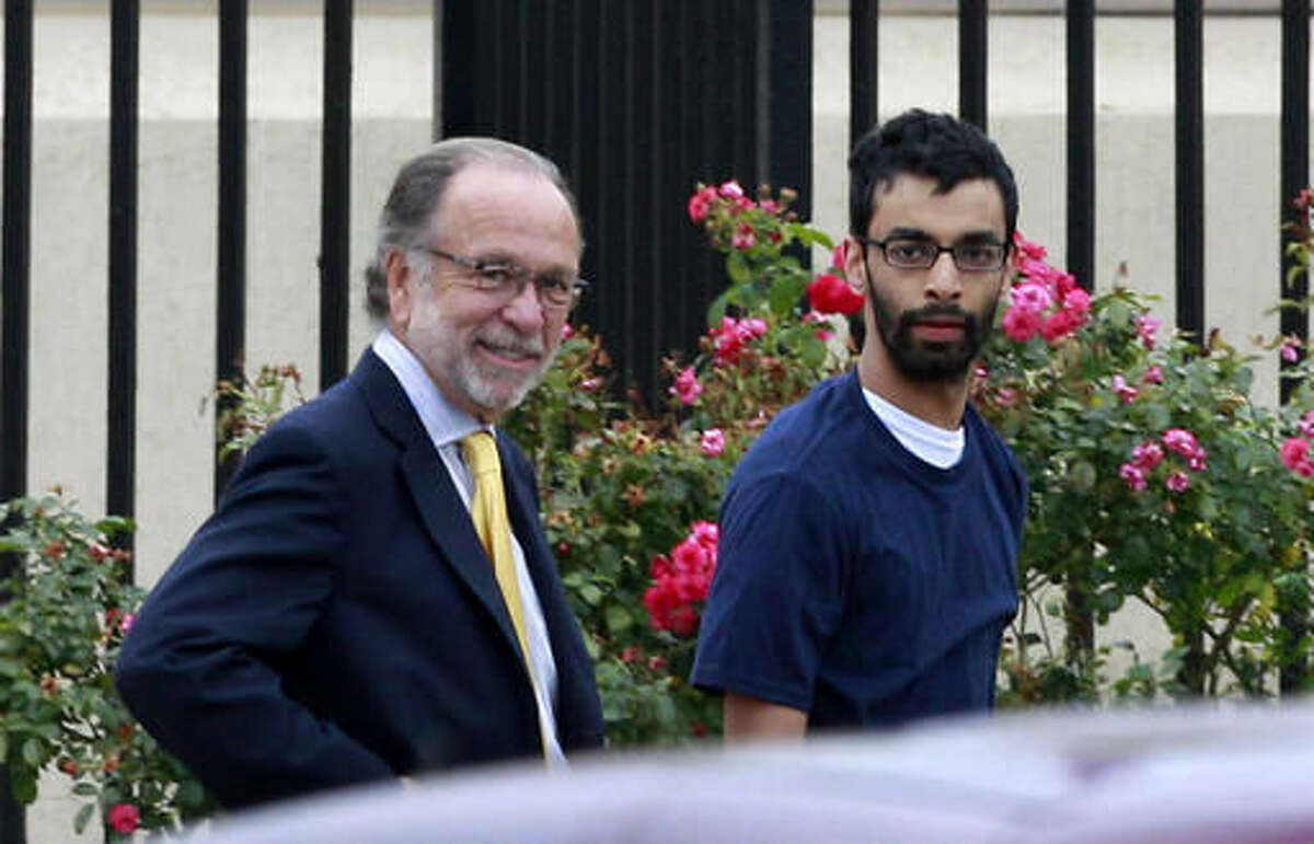 FILE - In this June 19, 2012, file photo, Dharun Ravi, right, and his attorney Steven Altman, left, walk out of Middlesex County jail in North Brunswick, N.J. Ravi, a former Rutgers University student, whose roommate Tyler Clementi killed himself in 2010 after being captured on a webcam kissing another man, pleaded guilty Thursday, Oct. 27, 2016, to attempted invasion of privacy, and was sentenced to probation and 30 days time served. (AP Photo/Mel Evans, File)