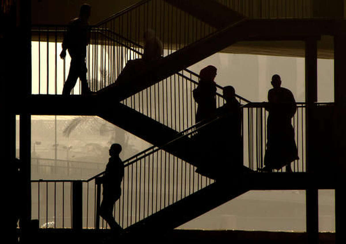 Egyptians walk down the stairs of a bridge in Cairo, Egypt, Thursday, Oct. 27, 2016. Egypt is suffering an acute foreign currency shortage because of the decimation of its lucrative tourism industry, a fall in Suez Canal revenues and reduced remittances from Egyptian expatriates. It also suffers from double digit rates of inflation and unemployment. (AP Photo/Amr Nabil)