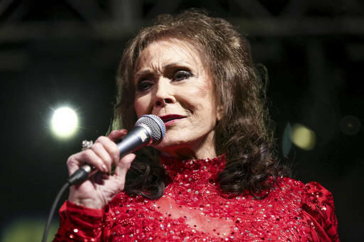 FILE - In this March 17, 2016 file photo, Loretta Lynn performs at the BBC Music Showcase at Stubb's during South By Southwest in Austin, Texas. The eight-time CMA winner was the very first female vocalist of the year and she's planning be at the 50th annual CMA Awards next Wednesday as many of her career milestones have played out on that stage. (Photo by Rich Fury/Invision/AP, File)