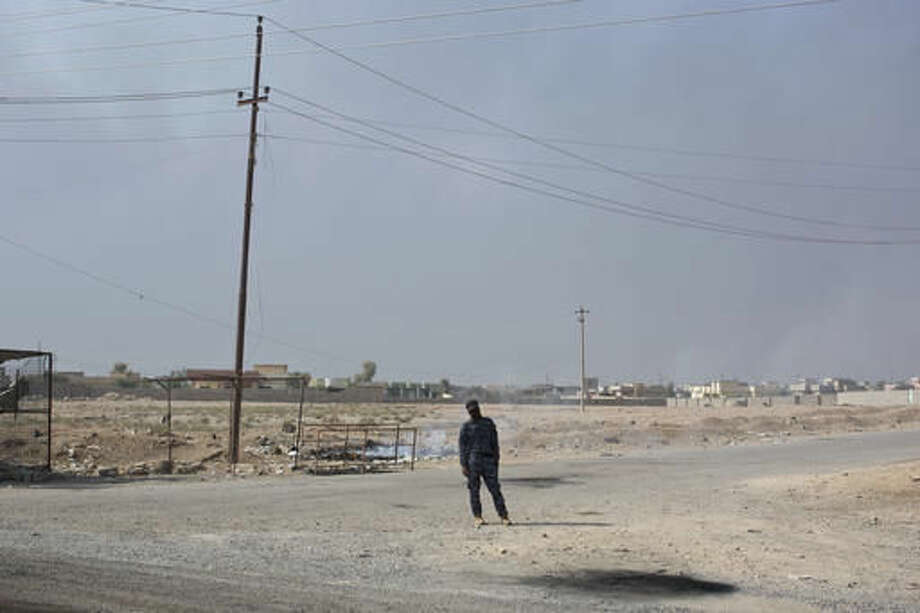 An Iraqi Federal Police officer stands guard at a checkpoint in the village of Al Hut, some 25 miles, 40 km, south of Mosul, Iraq, Thursday, Oct. 27, 2016. The U.N. says it is closely monitoring the Mosul operation and the treatment of internally displaced civilians, or IDPs. (AP Photo/Marko Drobnjakovic)