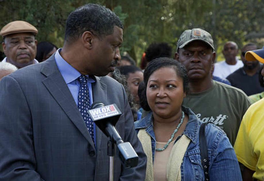 Derrick Johnson, left, president of the Mississippi NAACP, left, talks to Stacey Payton, center, with Hollis Payton, behind her, parents of a high school student, in front of the Stone County Courthouse in Wiggins, Miss., Monday, Oct. 24, 2016. Johnson is demanding a federal investigation after the parents said four white students put a noose around their son's neck at school. (AP Photo/Max Becherer)