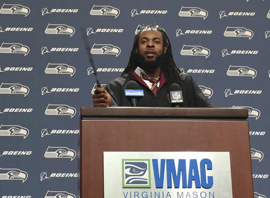 Seattle Seahawks NFL football cornerback Richard Sherman talks to reporters while dressed as a wizard from the Harry Potter movie and book series, Wednesday, Oct. 26, 2016, at Seahawks headquarters in Renton, Wash. From Sunday night to Monday morning, Sherman was suffering from dehydration and fatigue on the flight back to Seattle after being on the field for nearly 100 plays and more than 46 minutes of game time in the Seahawks' 6-6 tie with the Arizona Cardinals. (Stephen Cohen/seattlepi.com via AP)