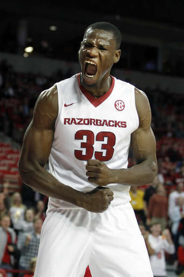FILE - In this Nov. 13, 2015, file photo, Arkansas' Moses Kingsley (33) shouts after dunking the ball during the second half of an NCAA college basketball game against Southern University, in Fayetteville, Ark. Arkansas stumbled to a .500 finish last season, hardly the follow-up coach Mike Anderson had hoped for following a 27-win effort the season before. The Razorbacks believe they are ready to return to that top form this season, thanks to an influx of top junior-college talent _ and the return of preseason SEC Player of the Year Moses Kingsley. (AP Photo/Samantha Baker, File)