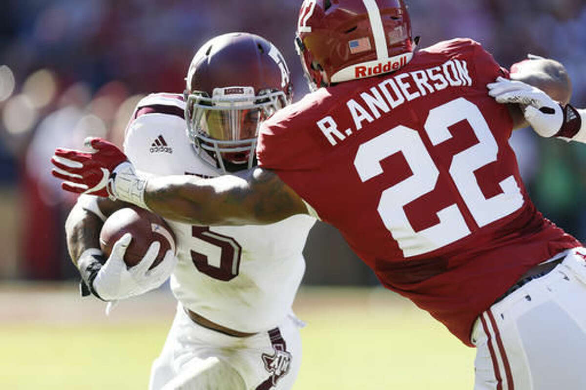 Alabama linebacker Ryan Anderson, right, attempts to tackle against Texas A&M running back Trayveon Williams during the first half of an NCAA college football game, Saturday, Oct. 22, 2016, in Tuscaloosa, Ala. (AP Photo/Brynn Anderson)