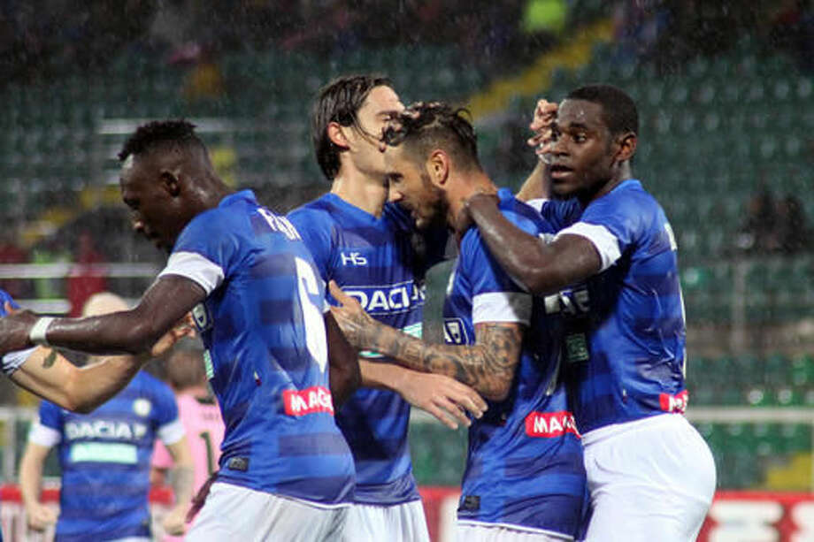 Udinese's Cyril Thereau, second from right, celebrates with teammates after scoring during a Serie A soccer match between Palermo and Udinese, at the Renzo Barbera stadium in Palermo, Italy, Thursday, Oct. 27, 2016. (Corrado Lannino/ANSA via AP)