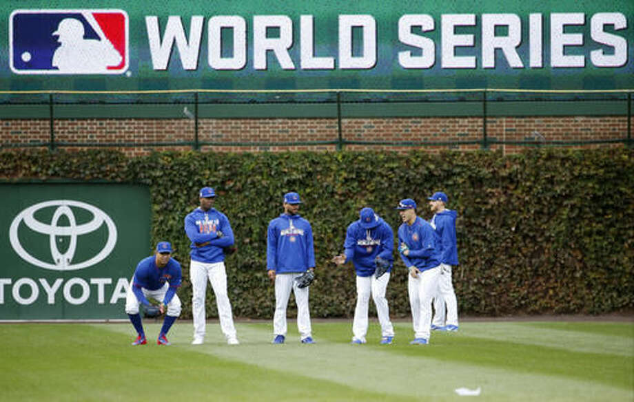 Chicago Cubs players work out in the outfield during batting practice for Friday's Game 3 of the Major League Baseball World Series against the Cleveland Indians, Thursday, Oct. 27, 2016, in Chicago. (AP Photo/Nam Y. Huh)