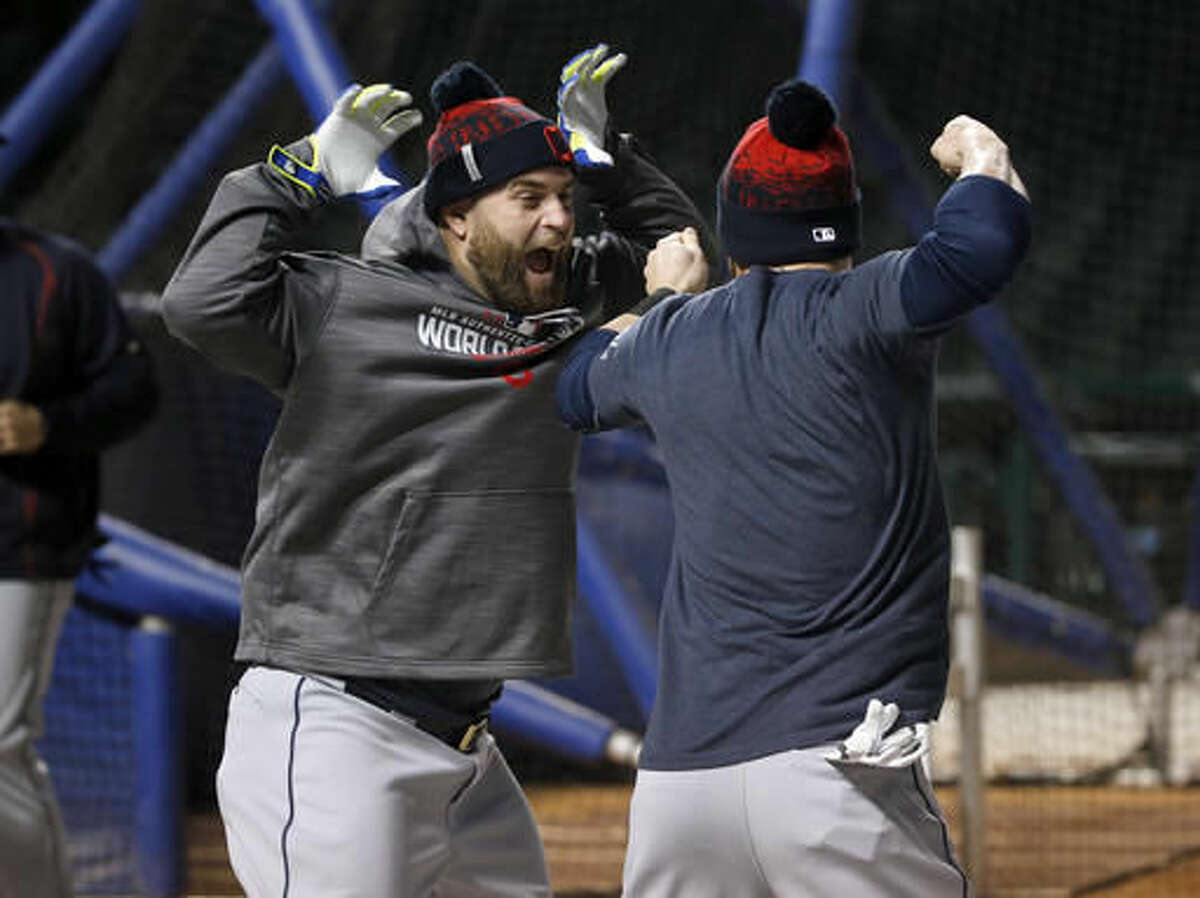 Cleveland Indians' Mike Napoli, left, and Jason Kipnis play around during batting practice for Game 3 of the Major League Baseball World Series against the Chicago Cubs, Thursday, Oct. 27, 2016, in Chicago. (AP Photo/Charles Rex Arbogast)