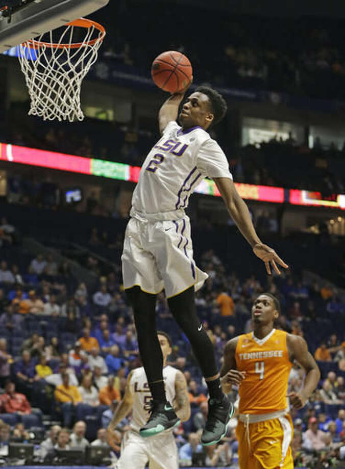 FILE - In this March 11, 2016, file photo, LSU's Antonio Blakeney (2) dunks as Tennessee's Armani Moore (4) looks on during the second half of an NCAA college basketball game in the Southeastern Conference tournament in Nashville, Tenn. Blakeney, who averaged 12.6 points per game as a freshman last season, is LSU's top returning scorer and is expected to emerge as a locker room leader this season as well.(AP Photo/Mark Humphrey,File)