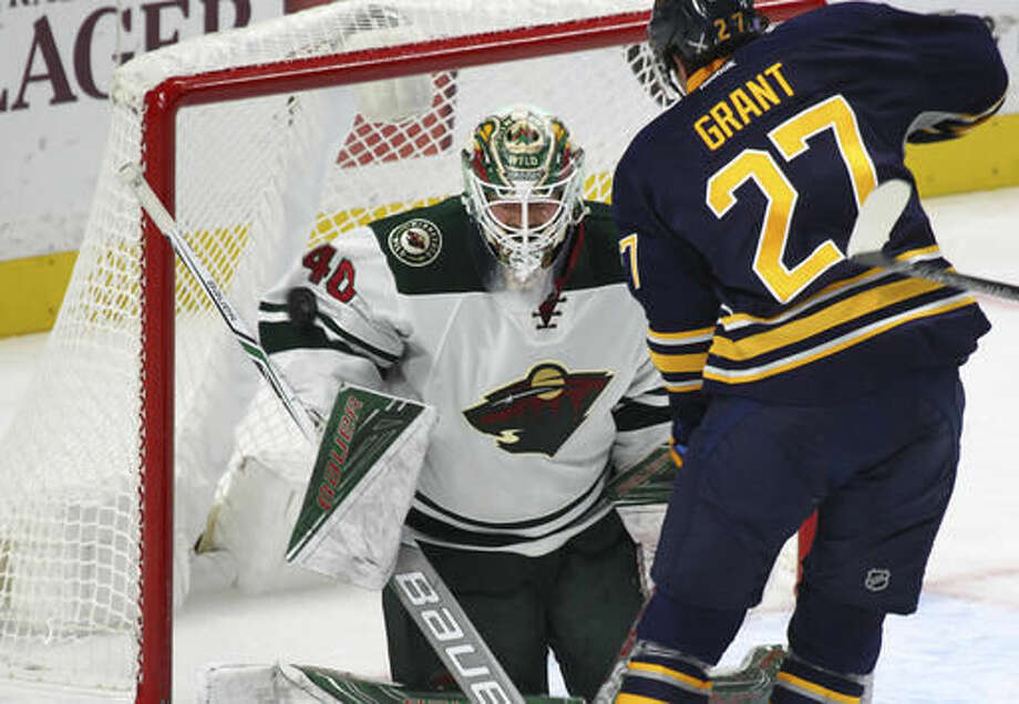 Buffalo Sabres' Derek Grant (27) is stopped by Minnesota Wild goalie Devan Dubnyk (40) during the second period of an NHL hockey game, Thursday, Oct. 27, 2016, in Buffalo, N.Y. (AP Photo/Jeffrey T. Barnes)